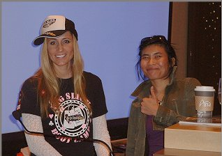 Poker Pro Vanessa Rousso posing with Main Event Prep Camp attendee in July 2011