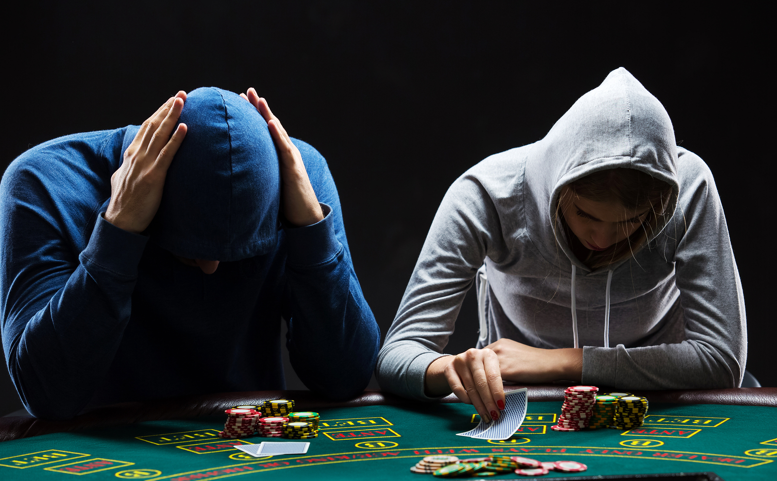 poker players with hoodies
